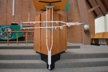 bandaid prayers on a crutch cross
