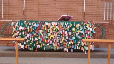 Prayer tags on altar